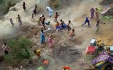 Pakistani Villagers Chase Supplies