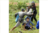 Thai Villager Attacks Protesters as Police Watch