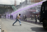 Painting Protesters Purple in Kashmir