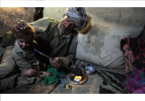 Opium Addict Gives Pipe to Grandson in Afghanistan