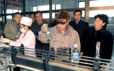 Kim Jong-il Studies a Bottle of Water