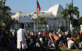Haitians Camp in Front of Damaged National Palace